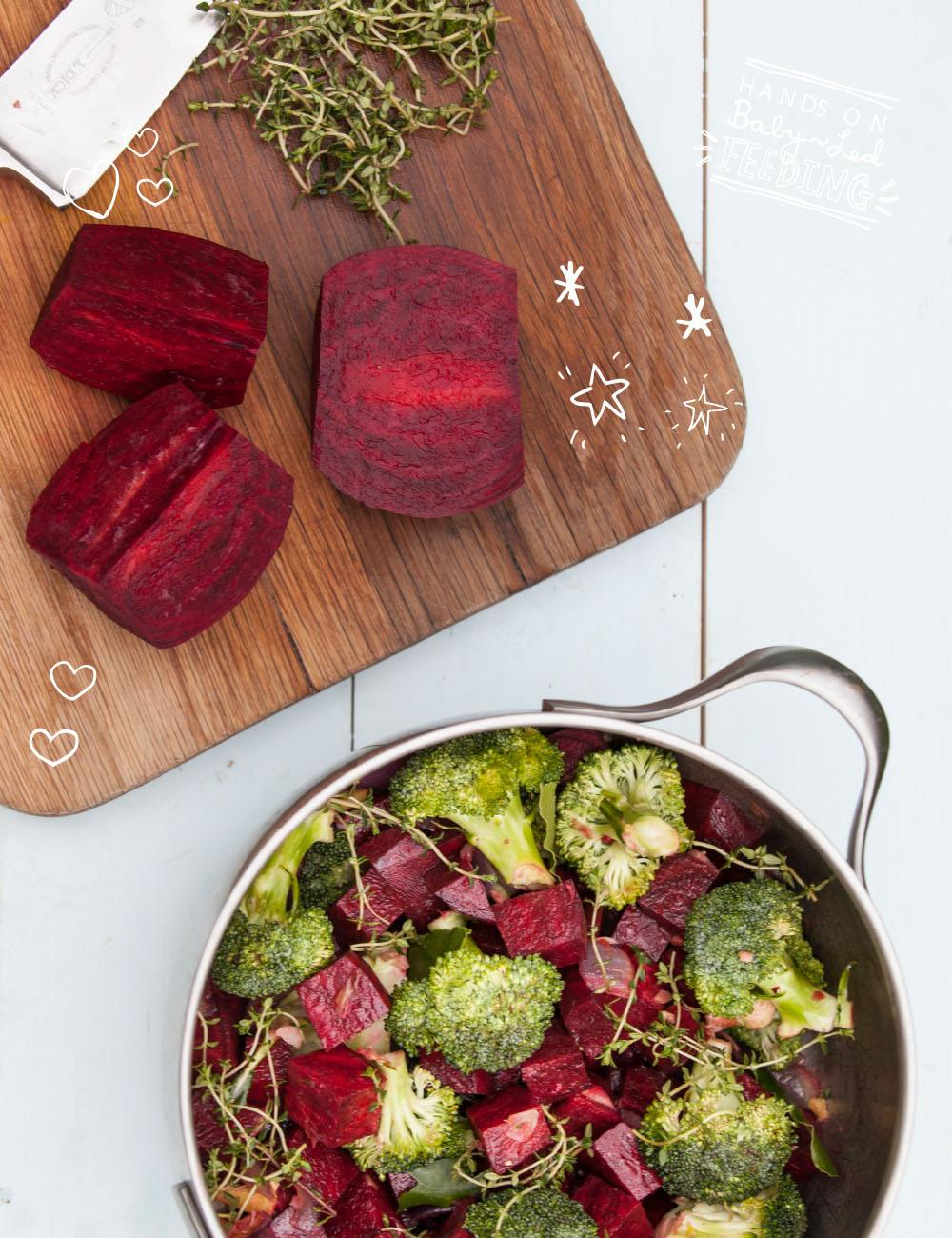 Easy and healthy beetroot and ginger soup for baby led weaning, toddlers, and parents alike. Made with colorful beetroot, flavorful fresh ginger, onion, hearty broccoli, nutty coconut milk, served with fresh yogurt and thyme. #beetroot #soup #souprecipe #valentinesdayideas #valentines #babyledweaning #babyledfeeding #soupinspiration