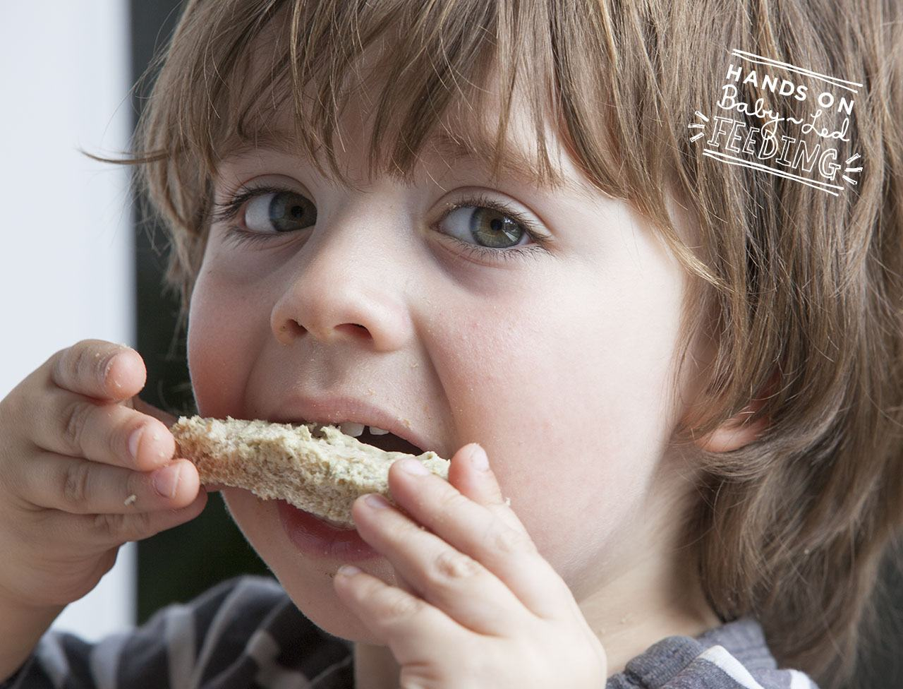 Baby led weaning mackerel pate with salad. Oscar eating pate image. This is a perfect baby lunch recipe packed with Omega-3 rich fish and full of vitamins. Lunch ideas for baby led weaning that are easy and quick. Yummy finger foods for babies. BLW lunch finger food recipe.