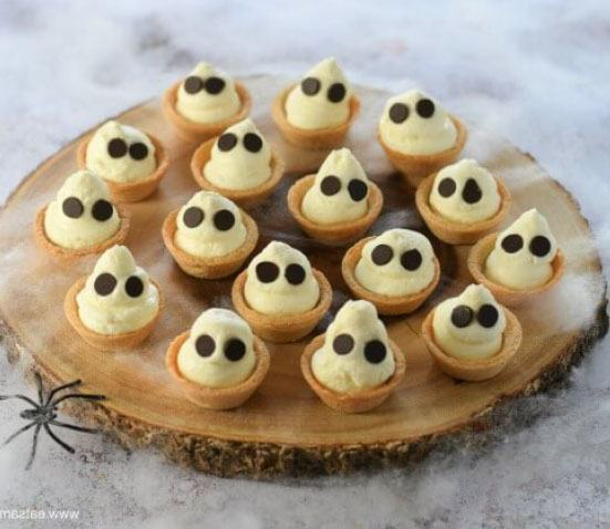 10 Healthy Halloween Foods to make right now! Baby and Toddler Finger Foods Ghostly Mini Cheesecake Bites from Eats Amazing. Homemade Baby Finger Food Recipes and Ideas for giving Your Baby Nutritious Finger Foods for the halloween season.
