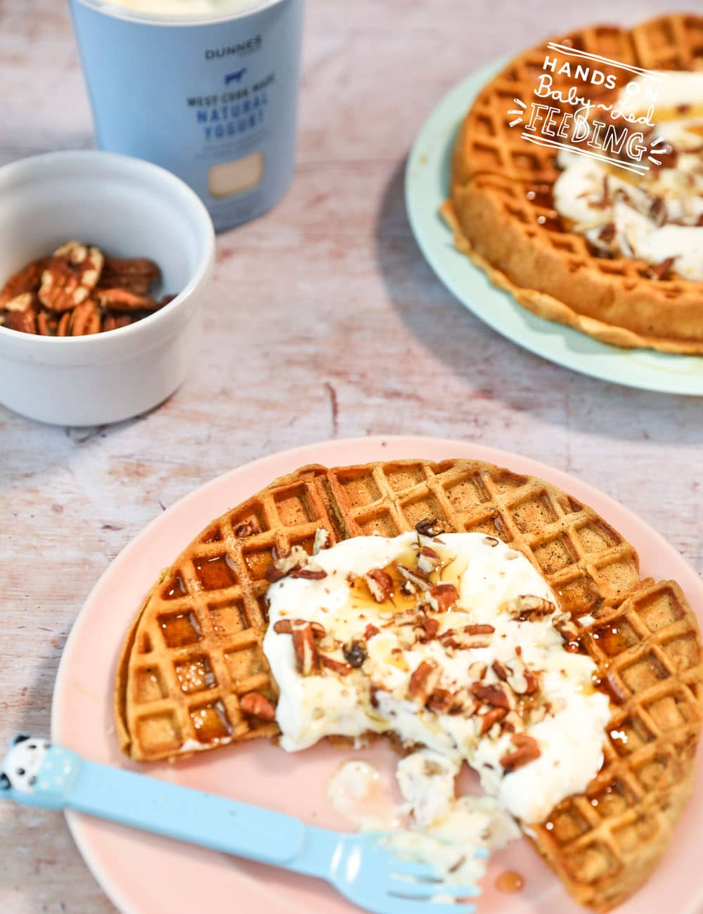 Easy and Healthy Sweet Potato Waffles with Crushed Pecans! Refined sugar free, baby led weaning friendly, family breakfast spiced with cinnamon, ginger, and ground nutmeg served with a dollop of protein rich Greek yogurt. #waffles #babyledfeeding #babyledweaning #sweetpotato #breakfast