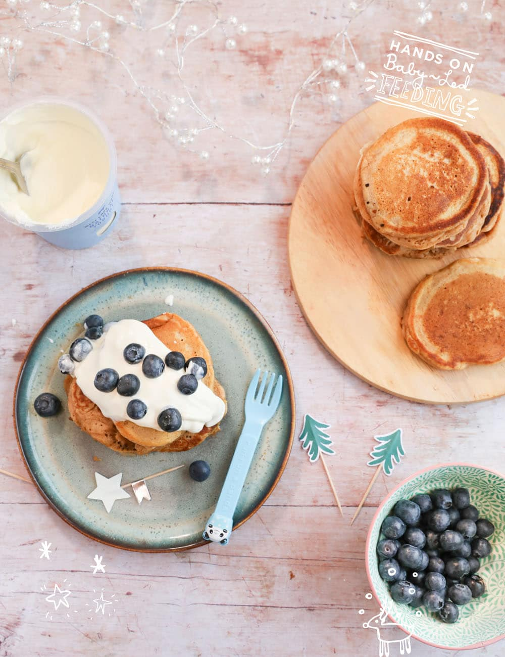 Light and fluffy sweet potato and buttermilk pancakes, spiced with cinnamon and nutmeg, topped with protein packed Greek yogurt and antioxidant rich blueberries. A healthy baby led weaning breakfast. This easy recipe makes a festive Christmas breakfast recipe! #sweetpotato #pancakes #christmasrecipe #holidayrecipe #babyledweaning #babyledfeeding
