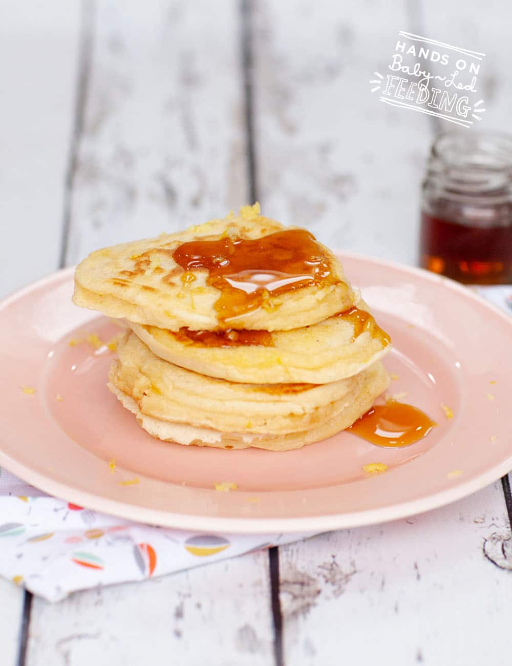 Zesty lemon and sweet maple syrup are the perfect combination in this super easy healthy baby led weaning pancake! This refined sugar free finger food can be made ahead and frozen for a quick breakfast idea on busy days. #pancakes #babyledweaning #pancakerecipe #breakfastrecipe #fingerfood #freezerfood