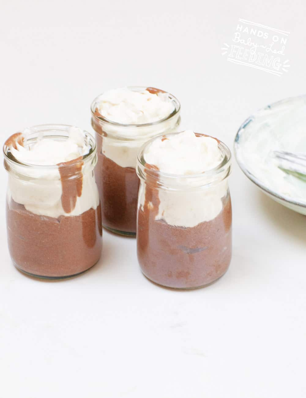 Easy Chocolate Avocado Mousse is made with fresh avocado and bananas! This healthy treat is one of the easiest baby led weaning recipe ever! Vegan and dairy free option and as always refined sugar free! #babyledweaning #babyledfeeding #healthysnacks