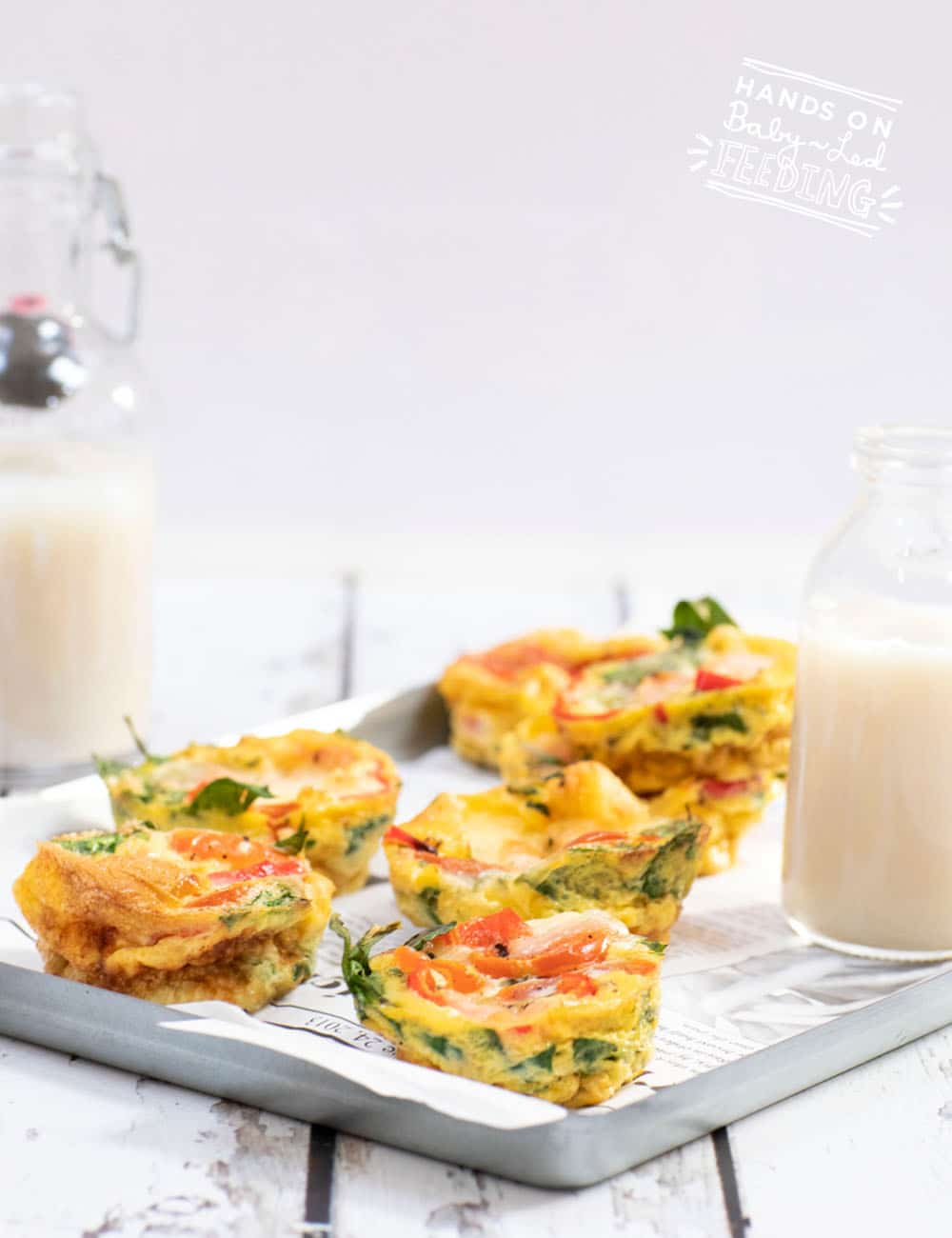 Easy Egg Breakfast Muffins are a healthy breakfast option for baby led weaning. Soft eggs and finely dices tomatoes, bell pepper, and spinach are easy for baby to chew even without teeth. #babyledweaning #babyledfeeding #breakfastrecipe