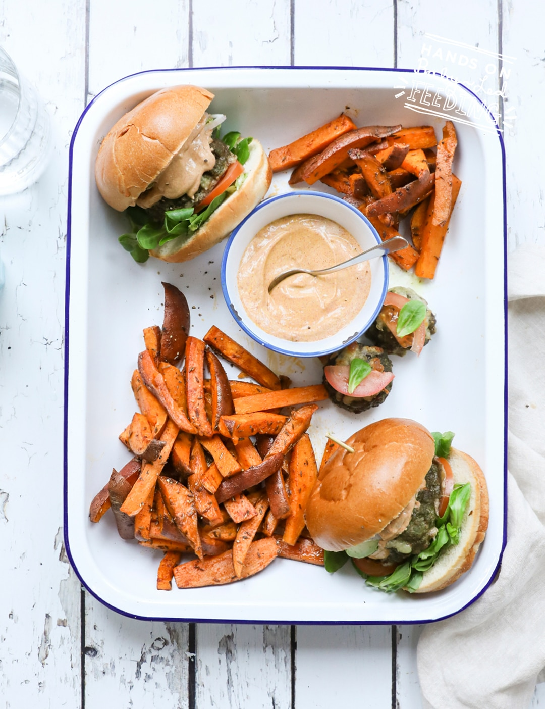 Veggie Loaded Baby Burgers with Cajun Sauce. This little burger is like an entire salad cooked into a slider sized burger! Served with a zesty (not spicy) yogurt based Cajun sauce and crispy-sweet sweet potato fries. #babyledweaning #sliders #bbq #healthyrecipe