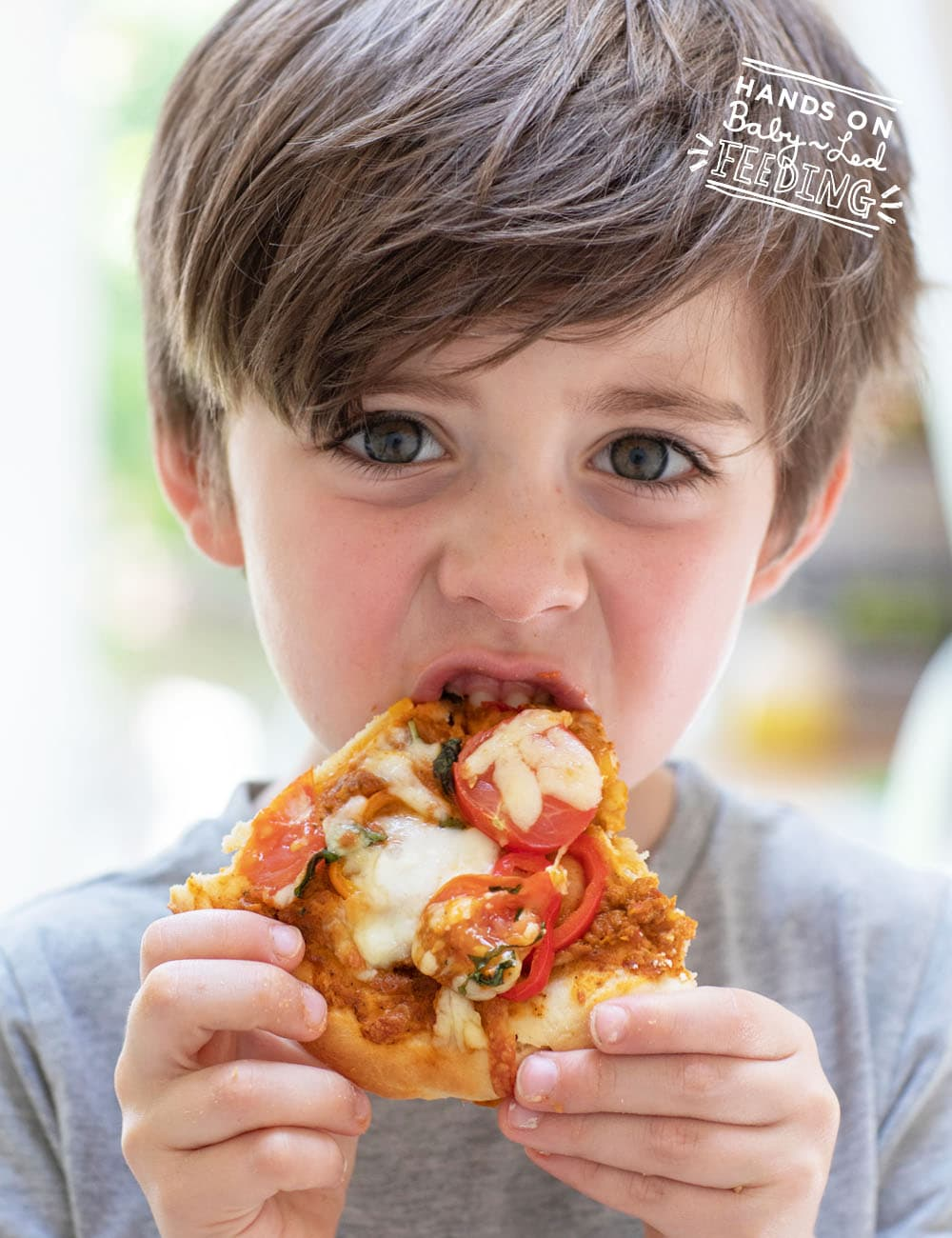 Juicy tomatoes and fresh sweet peppers give this healthy pizza a lightly sweet bite making it great for younger palates. Picky eater vegetable pizza is a family friendly nutritious recipe that only takes 10 minutes! #babyledweaning #pickyeater #toddlerfood #pizza #familyfood #refinedsugarfree