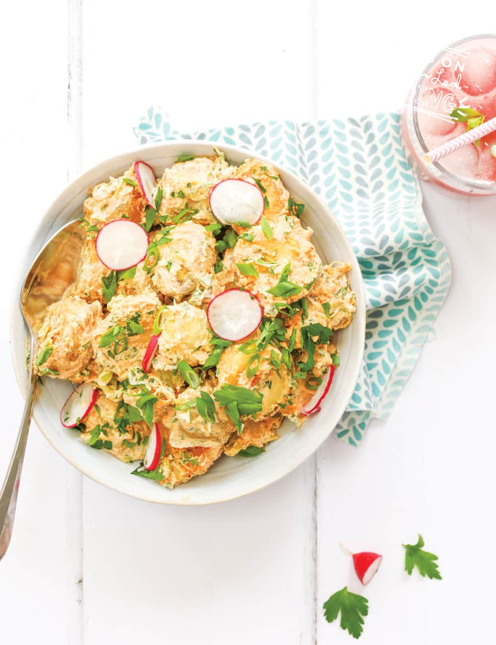 Easy baby led weaning side dish that is perfect to make ahead and super for a summer side dish. No mayo potato salad is made with healthy yogurt and seasoned with spring onions, lemons, apple cider vinegar and topped with zesty radishes. #healthysides #babyledweaning #potatosalad #makeahead #babyledfeeding #toddlerfood