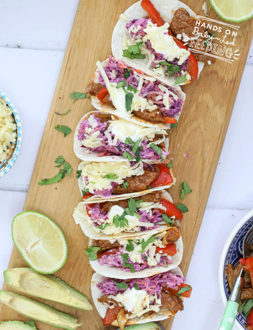 Two-Bite Beef Tacos with Sweet &Tangy Fresh Slaw. These easy little tacos are irresistible! Fully of healthy veggies hidden behind delicious homemade seasoning and a tangy sweet slaw made with apples, Greek yogurt and lemon. This easy healthy dinner is kid friendly, toddler friendly, and safe for baby led weaning. #babyledweaning #babyledfeeding #tacos #pickyeaters #kidfood #healthyrecipe