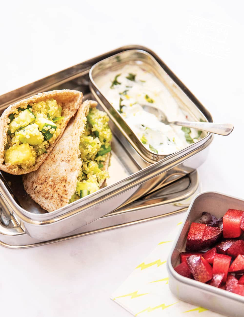 Pitta pockets with quinoa salad and yogurt dip. This is an easy and healthy toddler meal that is full of vegetables. Avocado, cucumber, lemon, and mint flavor this yummy lunch or dinner recipe!