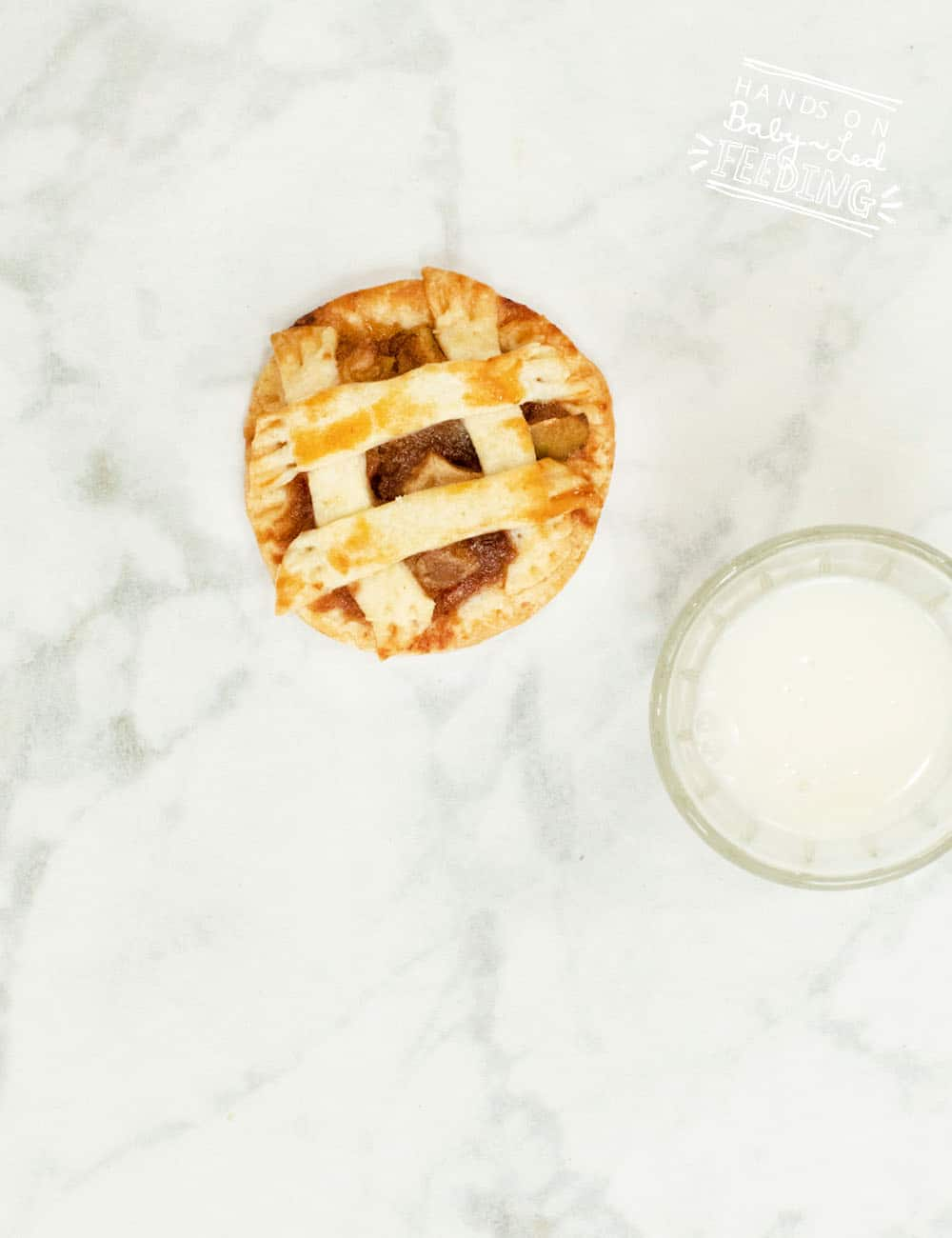 Fresh apple pie COOKIES! Homemade sweet apple filling with a light and crispy crust.The perfect finger food for baby and toddler hands. Refined sugar free treat that is perfect for baby led weaning snack! #babyledweaning #cookies #applepie #refinedsugarfree
