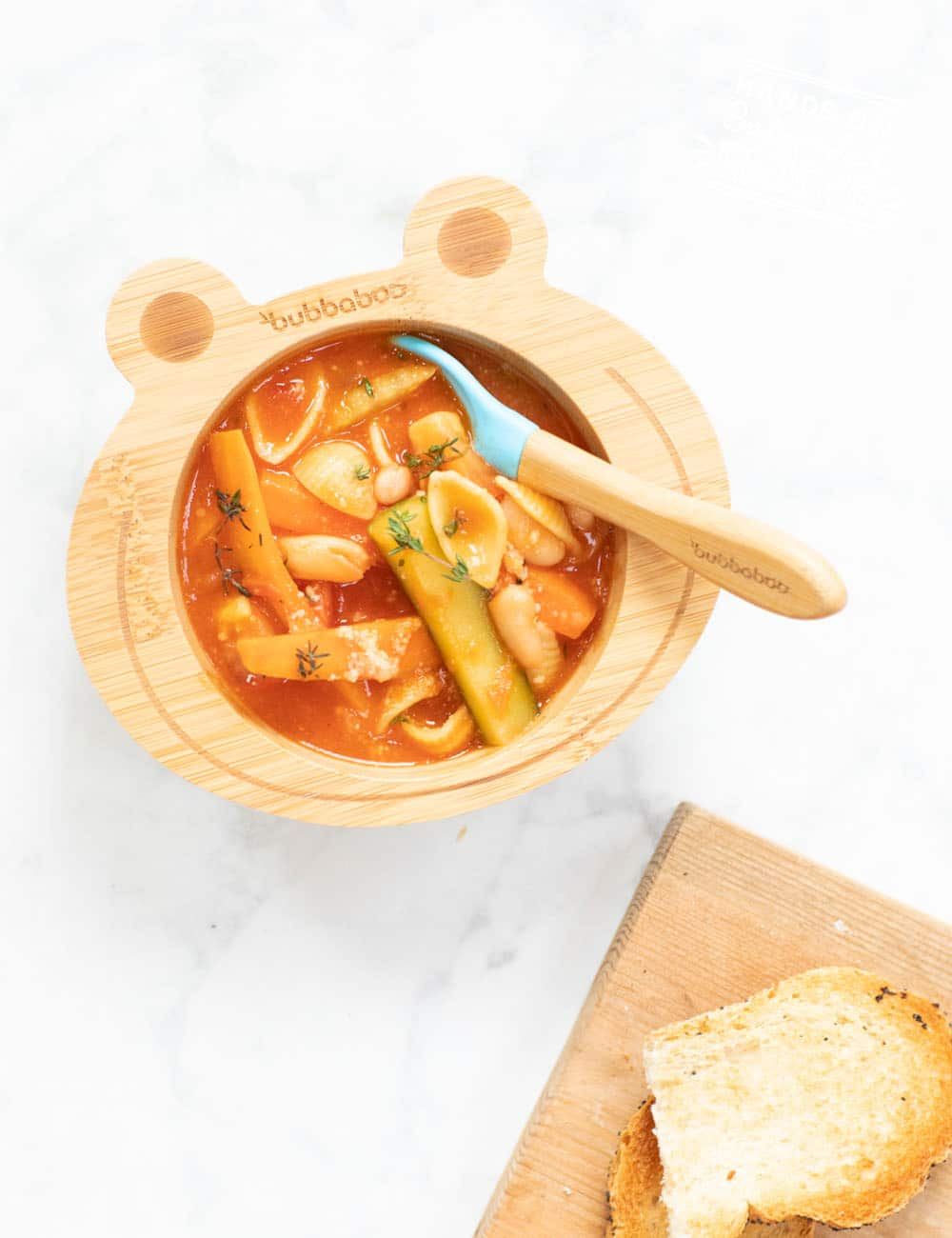 Warm Baby Led Weaning friendly veggie minestrone soup. Cutting veggies correctly for babies is the key to making this soup baby friendly! #soup #babyledweaning #vegan #vegetarian