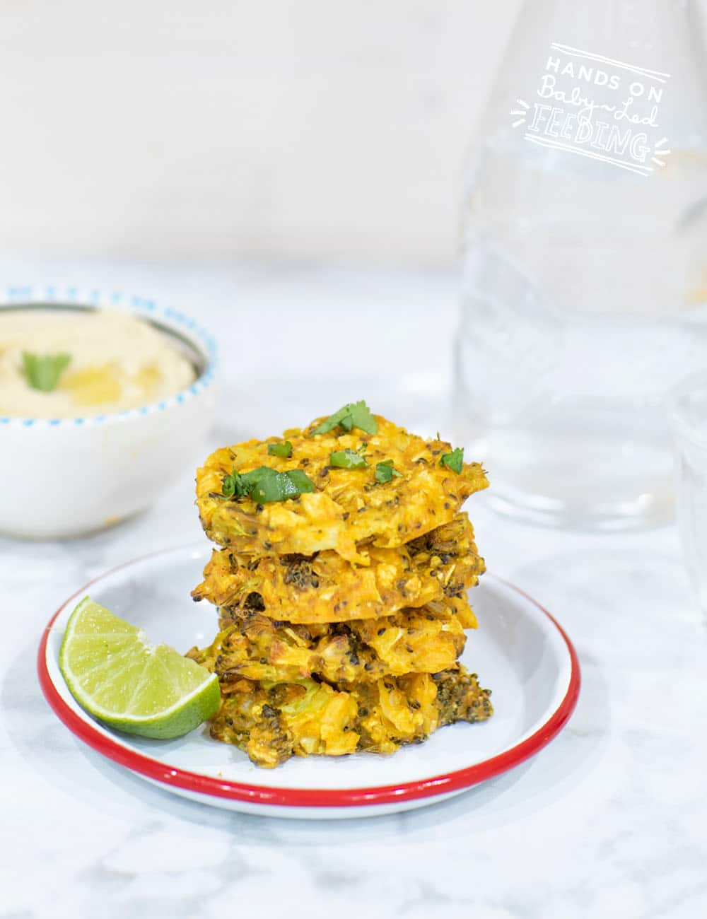 Egg free broccoli and cauliflower fritters for baby-led weaning. Easy and healthy vegan finger food for babies and toddlers. This healthy lunch or dinner recipe is baked in the oven not fried! #babyledweaning #fritters #eggfree #vegan #eggfree #healthylunch