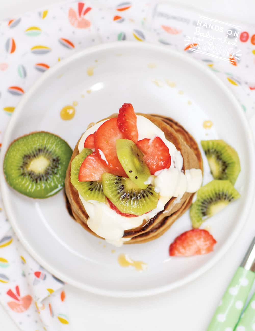 An easy & healthy idea for baby breakfast that can be made all in one blender! Made with nutritious oats and yummy strawberries, kiwi, and banana, this baby pancake is great for 6 mo+! Naturally sweetened with fruit, this healthy baby breakfast is refined sugar-free.