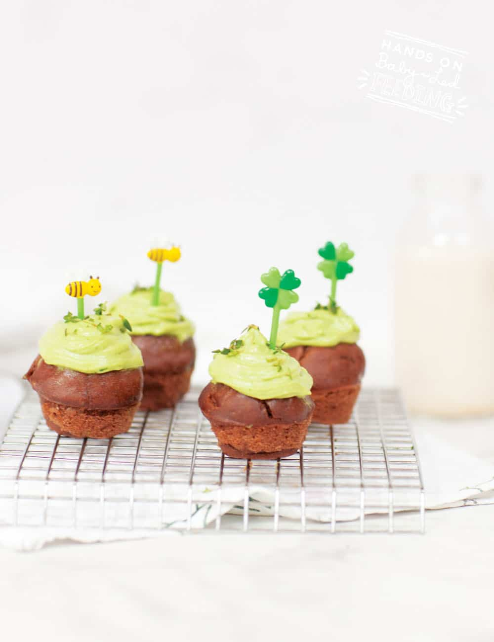 Healthy Brownie Bites for Baby Led Weaning. Refined sugar-free naturally sweetened with bananas! Vegan frosting naturally sweetened and colored! Healthy St. Patrick's Day recipe for kids! #irish #stpatricksday #browniebites #refinedsugarfree #bananas #babyledweaning #babyledfeeding #babyfood #fingerfood #partyfood #makeahead